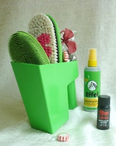 green scoop with green grooming tools
